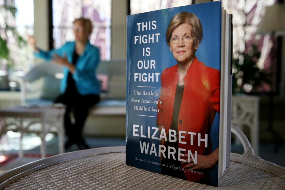 Cambridge, MA- April 14, 2017: This Fight is Our Fight by United States Senator Elizabeth Warren, background, at her home in Cambridge, MA on April 14, 2017. (Globe staff photo / Craig F. Walker) section: metro reporter